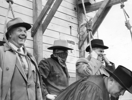 Villy Svarre, Pacific Great Eastern (PGE) general manager Einar Gunderson (left, head in noose) and Premier W.A.C. Bennett (right with black hat, head in noose) take part in the inaugural arrival ceremonies of the PGE in Williams Lake, B.C. August 30, 1956, courtesy The Province